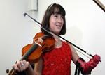 十岁女孩天生没左手 获3D打印义肢圆梦拉小提琴